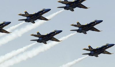 FILE - This March 23, 2014 file photo shows the U.S. Navy's Blue Angels flying over during the national anthem before the NASCAR Sprint Series auto race in Fontana, Calif. The Navy says a California-based officer, Capt. Gregory McWherter, has been relieved of duty because of unspecified alleged misconduct while he was commanding officer of the Blue Angels precision flying team(AP Photo/Alex Gallardo, File)