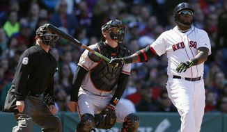 Boston Red Sox's David Ortiz watches his home run in front of Baltimore Orioles' Matt Wieters in the fourth inning of a  baseball game in Boston, Saturday, April 19, 2014. (AP Photo/Michael Dwyer)