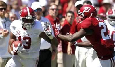 Wide receiver ArDarius Stewart (13) is pushed out of bounds by defensive back Nick Perry (27) after a a reception for a first down during Alabama's A-Day NCAA college football spring game Saturday, April 19, 2014, in Tuscaloosa, Ala. (AP Photo/Butch Dill)