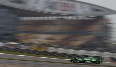 Caterham driver Kamui Kobayashi of Japan drives during his practice session for Sunday's Chinese Formula One Grand Prix at Shanghai International Circuit in Shanghai, China Saturday, April 19, 2014. (AP Photo/Andy Wong)