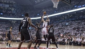 Toronto Raptors' Jonas Valanciunas shoots against the Brooklyn Nets during the first half of Game 1 of an opening-round NBA basketball playoff series, in Toronto on Saturday, April 19, 2014. (AP Photo/The Canadian Press, Chris Young)