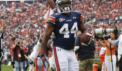Auburn running back Cameron Artis-Payne (44) celebrates with wide receiver Quan Bray (4) after scoring a touchdown in the first half of the annual A Day spring intrasquad NCAA college football game on Saturday, April 19, 2014, in Auburn, Ala. (AP Photo/John Bazemore)