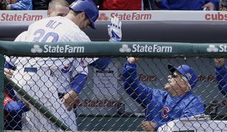 Chicago Cubs' Mike Olt, left, celebrates with manager Rick Renteria, right, and Anthony Rizzo after hitting a solo home run during the second inning of a baseball game against the Cincinnati Reds in Chicago, Saturday, April 19, 2014. (AP Photo/Nam Y. Huh)