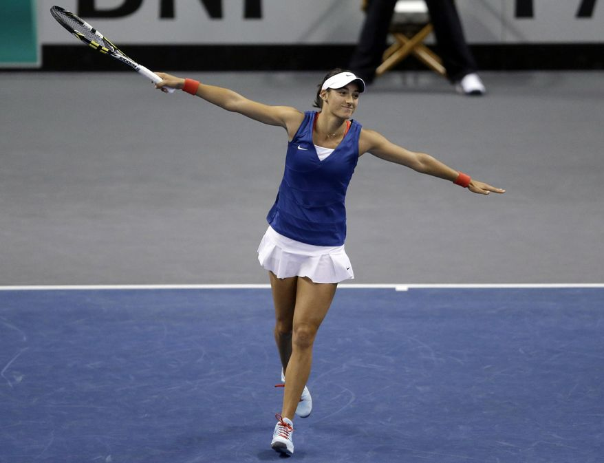 France's Caroline Garcia celebrates after defeating United States' Sloane Stephens 6-3, 6-2 in a Fed Cup singles world group match Saturday, April 19, 2014, in St. Louis. (AP Photo/Jeff Roberson)