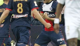 Paris Saint Germain's Edinson Cavani of Argentina, center, celebrates scoring against Olympic Lyonnais during the French League Cup Final soccer match at the Stade de France in Saint Denis, north of Paris, Saturday April 19, 2014. (AP Photo/Jacques Brinon)