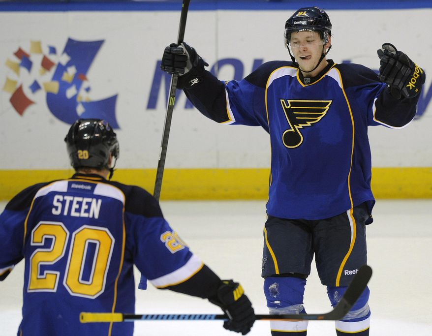 St. Louis Blues' Vladimir Tarasenko (91), of Russia, celebrates with teammate Alexander Steen (20) after his game-tying goal against the Chicago Blackhawks during the third period in Game 2 of a first-round NHL hockey playoff series, Saturday, April 19, 2014, in St. Louis. (AP Photo/Bill Boyce)