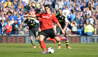 Cardiff City's Peter Whittingham scores his side's first goal of the game during their English Premier League soccer match against Stoke City at the Cardiff City Stadium, Cardiff, Wales, Saturday, April 19, 2014. (AP Photo/Andrew Matthews, PA Wire)     UNITED KINGDOM OUT    -   NO SALES    -    NO ARCHIVES