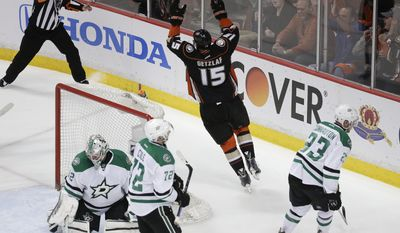 Anaheim Ducks' Ryan Getzlaf(15) celebrates his goal as he skates near Dallas Stars' Kari Lehtonen (32), of Finland; Erik Cole (72); and Kevin Connauton (23) during the first period in Game 2 of the first-round NHL hockey Stanley Cup playoff series on Friday, April 18, 2014, in Anaheim, Calif. (AP Photo/Jae C. Hong)