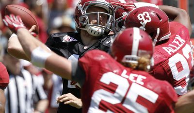 Alabama quarterback Alec Morris (11) is sacked by Jonathan Allen (93) and others during the A-Day NCAA college football spring game Saturday, April 19, 2014, in Tuscaloosa, Ala. (AP Photo/Butch Dill)
