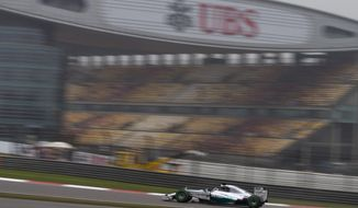 Mercedes driver Lewis Hamilton of Britai10drives during his practice session for Sunday's Chinese Formula One Grand Prix at Shanghai International Circuit in Shanghai, China Saturday, April 19, 2014. (AP Photo/Andy Wong)