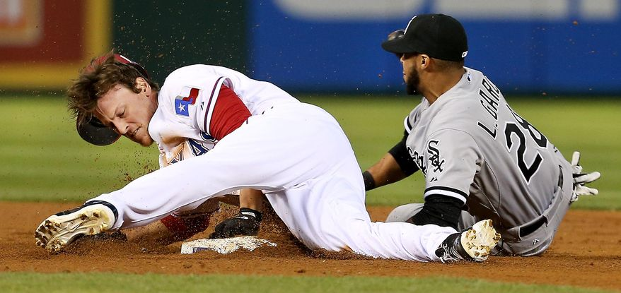 Texas Rangers' Jim Adduci slides into second for a double in front of the tag by Chicago White Sox second baseman Leury Garcia during the third inning of a baseball game Friday, April 18, 2014, in Arlington, Texas. The Rangers won 12-0. (AP Photo/The Dallas Morning News, Brad Loper) MANDATORY CREDIT, NO SALES, MAGS OUT, TV OUT, INTERNET USE BY AP MEMBERS ONLY