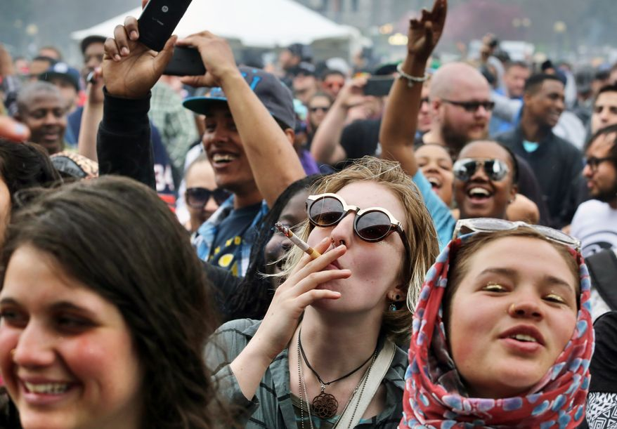 With the Colorado state capitol building visible in the background, partygoers dance to live music and smoke pot on the first of two days at the annual 4/20 marijuana festival in Denver, Saturday April 19, 2014. The annual event is the first 420 marijuana celebration since retail marijuana stores began selling in January 2014. (AP Photo/Brennan Linsley)