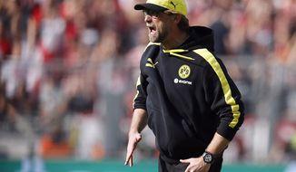Dortmund head coach Juergen Klopp shouts during the German first division Bundesliga soccer match between BvB Borussia Dortmund and Mainz 05 in Dortmund, Germany, Saturday, April 19, 2014. (AP Photo/Frank Augstein)