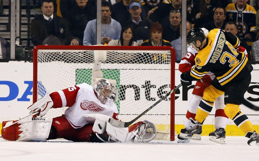 Detroit Red Wings goalie Jimmy Howardmakes a save on Boston Bruins' Carl Soderberg (34) during the third period of Detroit's 1-0 win in Game 1 of a first-round NHL playoff hockey series, in Boston on Friday, April 18, 2014. (AP Photo/Winslow Townson)