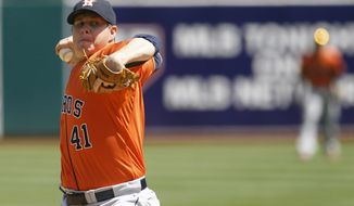 Houston Astros pitcher Brad Peacock delivers a pitch during a baseball game against the Oakland Athletics in Oakland, Calif. on Sunday, April 20, 2014. (AP Photo/Matthew Sumner)