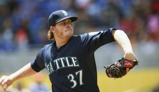 Seattle Mariners starter Brandon Maurer pitches to the Miami Marlins during the first inning of a baseball game in Miami, Sunday, April 20,2014. (AP Photo/J Pat Carter)