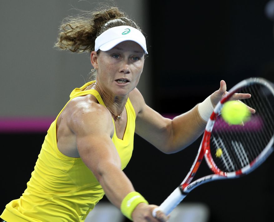 Samantha Stosur of Australia plays a shot in her match against Angelique Kerber of Germany during the Fed Cup semifinals between Australia and Germany in Brisbane, Australia, Sunday, April 20, 2014. (AP Photo/Tertius Pickard)