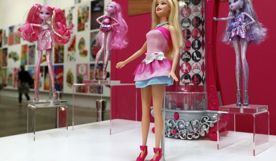 """In this Oct. 11, 2010 photo, a display of dolls, clothes, sets and accessories tied to a """"Barbie, A Fashion Fairytale"""" promotion, are seen in a break area at the Design Center at the corporate headquarters campus of Mattel, Inc., in El Segundo, Calif. Barbie is among the easily recognizable product names that have appeared on standardized tests in New York taken by grades three through eight. Although education officials in New York State and the test publisher deny it, some parents wonder whether companies have paid to have their product names placed on the tests. (AP Photo/Reed Saxon, File)"""