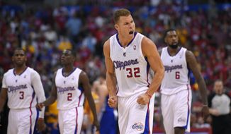 Los Angeles Clippers forward Blake Griffin, second from right, tries to fire up fans as Chris Paul, left, Darren Collison, second from left, and DeAndre Jordan look on during the second half in Game 1 of an opening-round NBA basketball playoff series, Saturday, April 19, 2014, in Los Angeles. The Warriors won 109-105. (AP Photo/Mark J. Terrill)