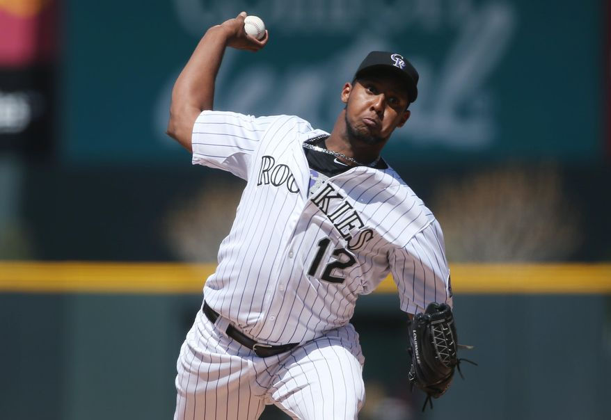 Colorado Rockies starting pitcher Juan Nicasio works against the Philadelphia Phillies in the first inning of a baseball game in Denver on Sunday, April 20, 2014. (AP Photo/David Zalubowski)