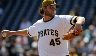 Pittsburgh Pirates starting pitcher Gerrit Cole delivers during the second inning of a baseball game against the Milwaukee Brewers in Pittsburgh, Sunday, April 20, 2014. (AP Photo/Gene J. Puskar)