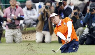 Minami Katsu hits out of a bunker on the 18th hole during the Vantelin Ladies Open golf tournament at Kumamoto Airport Country Club in Kumamoto, southwestern Japan, Sunday, April 20, 2014. Katsu, a 15-year-old Japanese high school student, won the tournament to become the youngest winner in the history of the Japan LPGA tour. (AP Photo/Kyodo News) JAPAN OUT, CREDIT MANDATORY