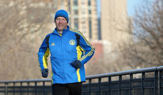 In this April 8, 2014 photo, Boston marathon qualifier Mike Johnson trains along the river near downtown Minneapolis, Minn. More than 600 Minnesota runners will line up for the start of the Boston Marathon this year, including 212 who ran last year and say they're going back to finish what they started. (AP Photo/The Star Tribune, Elizabeth Flores)