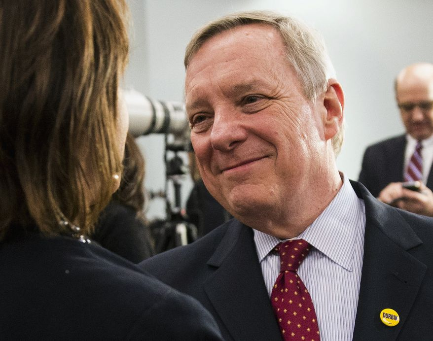 FILE - In this March 18, 2014 file photo, U.S. Sen. Dick Durbin, D-Ill., greets guests during Illinois Gov. Pat Quinn's election night reception in Chicago. Durbin is being challenged by Republican Jim Oberweis in the November election and said he is taking his opponent seriously, even if many others are not. Political prognosticators and even some top Republicans say Durbin's rival is a long shot to unseat the Senate's second-ranking Democrat. (AP Photo/Andrew A. Nelles, File)