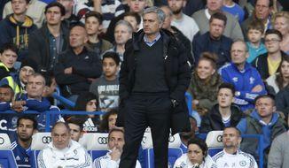Chelsea manager Jose Mourinho watches the English Premier League soccer match against Sunderland at the Stamford Bridge ground in London, Saturday, April 19, 2014. Sunderland won the match 2-1. (AP Photo/Lefteris Pitarakis)