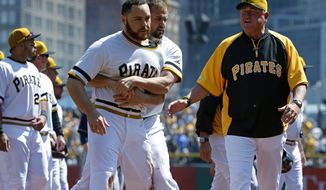 Pittsburgh Pirates' Russell Martin (55) is restrained by teammate Gaby Sanchez, center, as they walk to the dugout with manager Clint Hurdle, right, after a brawl between the Pittsburgh Pirates and the Milwaukee Brewers during the third inning of a baseball game in Pittsburgh Sunday, April 20, 2014. Brewers' Carlos Gomez and Pirates' Travis Snider were ejected from the game. (AP Photo/Gene J. Puskar)