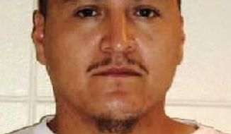 This photo provided by South Dakota Department of Corrections shows Paul Trejo. State corrections officials say Trejo walked away from the Rapid City Minimum Unit between Saturday night and Sunday, April 20, 2014. (AP Photo/South Dakota Department of Corrections)