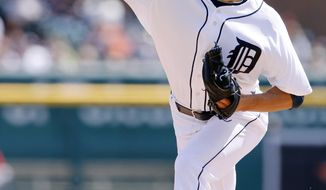 Detroit Tigers pitcher Rick Porcello delivers against the Los Angeles Angels during the second inning of a baseball game Sunday, April 20, 2014, in Detroit. (AP Photo/Duane Burleson)