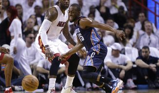 Charlotte Bobcats' Kemba Walker (15) and Miami Heat's LeBron James (6) eye a loose ball during the first half in Game 1 of an opening-round NBA basketball playoff series, Sunday, April 20, 2014, in Miami. (AP Photo/Lynne Sladky)