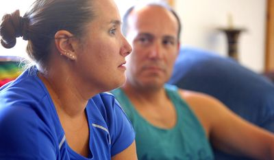 Sergio Celis, right, watches as his wife Becky discusses  the case of their missing daughter, Isabel, in their Tucson, Ariz., home on Monday, April 14, 2014.  (AP Photo/ Arizona Daily Star, Ron Medvescek)