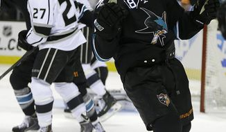 San Jose Sharks' Mike Brown, right, celebrates after scoring against the Los Angeles Kings during the second period of Game 2 of an NHL hockey first-round playoff series Sunday, April 20, 2014, in San Jose, Calif. (AP Photo/Ben Margot)