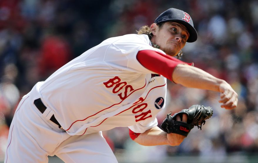 Boston Red Sox starting pitcher Clay Buchholz delivers against the Baltimore Orioles during the first inning of a baseball game at Fenway Park in Boston Monday, April 21, 2014. (AP Photo/Winslow Townson)