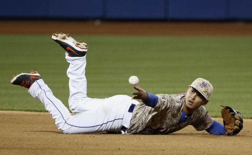 New York Mets shortstop Ruben Tejada (11) throws from his belly to New York Mets second baseman Daniel Murphy help turn a fifth-inning double play that St. Louis Cardinals Jon Jay hit into in a baseball game in New York, Monday, April 21, 2014. (AP Photo/Kathy Willens)