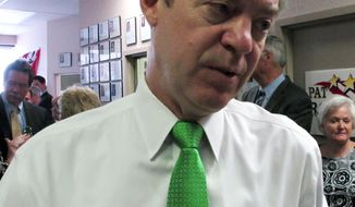 Kansas Gov. Sam Brownback answers questions from reporters following a reception for former U.S. Senate Majority Leader Bob Dole, Monday, April 21, 2014, in Overland Park, Kan. Brownback has signed a school funding bill that eliminates tenure for public school teachers. (AP Photo/John Hanna)