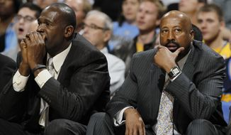 "FILe - In this March 13, 2013 file photo, New York Knicks head coach Mike Woodson, right, joins assistant coach Herb Williams in reacting as the Knicks fall behind to the Denver Nuggets in the third quarter of the Nuggets' 117-94 victory in an NBA basketball game in Denver. The Knicks have fired Woodson after falling from division champions to out of the playoffs in one season. New team president Phil Jackson made the decision Monday, April 21, 2014, saying in a statement ""the time has come for change throughout the franchise.""  (AP Photo/David Zalubowski, File)"