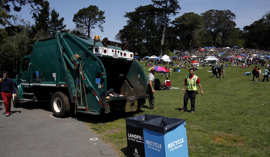 A garbage truck sits ready to haul away trash during the annual 4/20 pot-smoking celebration  at Hippie Hill in Golden Gate Park in San Francisco, Calif., on Sunday, April 20, 2014 in this file photo. (AP Photo/ San Francisco Chronicle, Sarah Rice) **FILE**