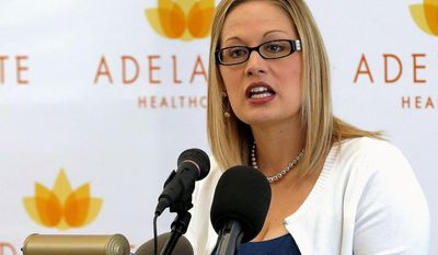 Rep. Kyrsten Sinema, Arizona Democrat, puts politics aside when she fights for physical endurance. She will be participating in the Boston Marathon to honor victims of the bombings last year. (Associated Press)