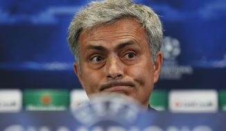 Chelsea's coach Jose Mourinho from Portugal gestures during a press conference ahead of Tuesday's Champions League, semifinal, first leg, soccer match against Atletico Madrid, at the Vicente Calderon stadium, in Madrid, Spain, Monday, April 21, 2014. (AP Photo/Andres Kudacki)