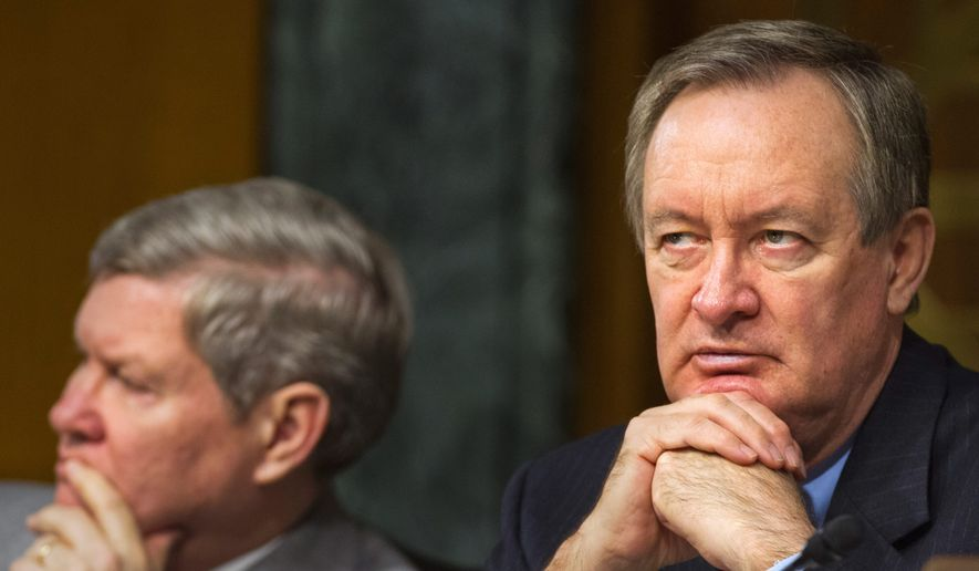 "Senate Banking Committee Chairman Mike Crapo, Idaho Republican and sponsor of the measure that President Trump will sign into law, said the moment was ""years in the making."" (ASSOCIATED PRESS)"
