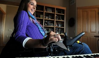 Tasha Schuh plunks out notes on a keyboard in her Ellsworth, Wis. home on Wednesday April 9, 2014. Schuh, 33, who is paralyzed from the chest down, is an inspirational speaker and shares her message with thousands of people each year at churches, schools and businesses around the country. Schuh, a junior in high school at the time, was injured when she fell 16 feet through a trap door in the stage of the Sheldon Theater in Red Wing, Minn while performing in a school play. She landed on her head on the concrete floor, breaking her neck, crushing her spinal cord and fracturing her skull. (AP Photo/St. Paul Pioneer Press, Jean Pieri)