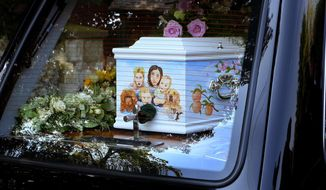The coffin of late Peaches Geldof, the daughter of rock singer Sir Bob Geldof, arrives at his home ahead of her funeral service at St Mary Magdalene and St Lawrence Church in Davington, near Faversham, England, Monday April 21, 2014. The 25-year-old television presenter, model and socialite, Peaches Geldof died suddenly two weeks ago at her home, and the cause of death is not yet known after a post-mortem was inconclusive, and toxicology test results are not yet complete.  The coffin is adorned with a painted picture of Peaches Geldof, her husband Thomas Cohen, their two young sons Astala, 23 months, and 11-month-old Phaedra, and pet dogs. (AP Photo / Gareth Fuller, PA) UNITED KINGDOM OUT - NO SALES - NO ARCHIVES