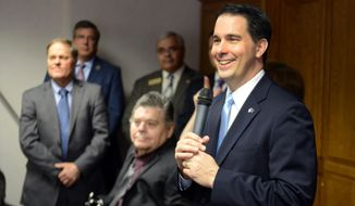 Wisconsin Gov. Scott Walker smiles during an event to announce the expansion of Family Care, a state-administered program that provides long-term care to disabled and elderly residents under Medicaid during an event at Options for Independent Living in Green Bay Monday, April 21, 2014.    (AP Photo/Press-Gazette Media, Jim Matthews)