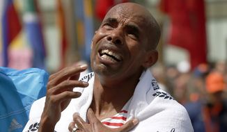 Meb Keflezighi, of San Diego, Calif., becomes emotional after winning the 118th Boston Marathon, Monday, April 21, 2014, in Boston. (AP Photo/Elise Amendola)