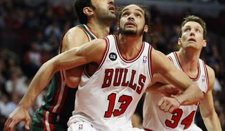 FILE - In this April 4, 2014 file photo, Chicago Bulls center Joakim Noah (13) defends against Milwaukee Bucks center Zaza Pachulia during an NBA basketball game in Chicago.  A person familiar with the situation says that Noah is the NBA's Defensive Player of the Year. The person spoke Monday, April 21, 2014 on the condition of anonymity because the award had not been announced. (AP Photo/Kamil Krzaczynski, File)