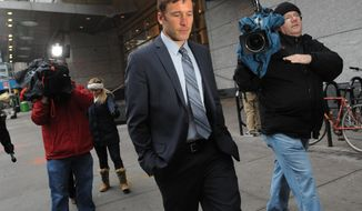 FILE - In this Dec. 9, 2013 file photo, Olympic skier Bode Miller exits family court in New York. Miller and former Marine Sara McKenna have reached a temporary truce in their custody fight over their 14-month-old son. McKenna and the Sochi bronze medalist will share time with the toddler over the next four months. Monday's, April 21, 2014  agreement came shortly before both parents were to testify at a Manhattan Family Court hearing. (AP Photo/ Louis Lanzano, File)