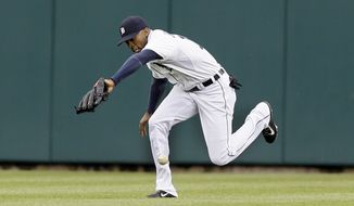 Detroit Tigers center fielder Austin Jackson misplays the fly hit by Chicago White Sox Jordan Danks during the first inning of a baseball game in Detroit, Monday, April 21, 2014. (AP Photo/Carlos Osorio)